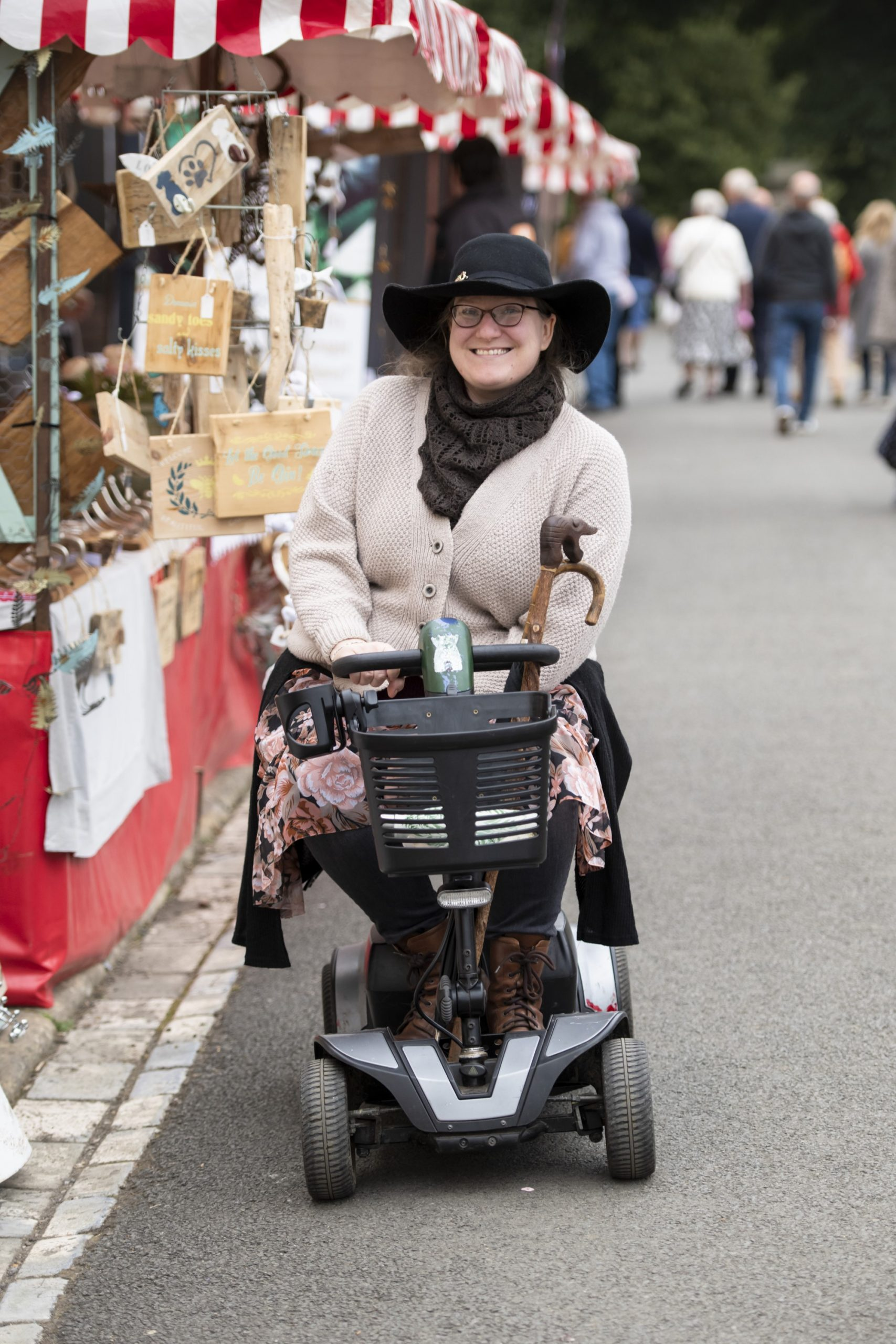Visitor on a motorised scooter at Raby Castle's summer market